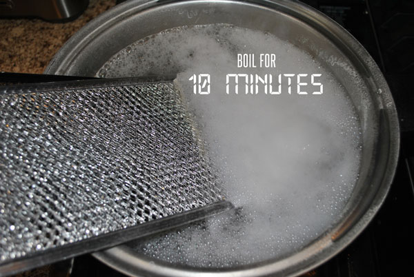 Boil the ovens filters in order to clean them.