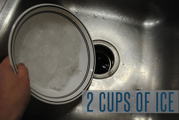 Start cleaning your garbage disposal using 2 cups of ice.
