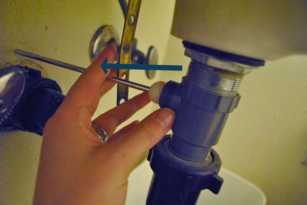Remove pivot rod from sink pop up drain assembly.