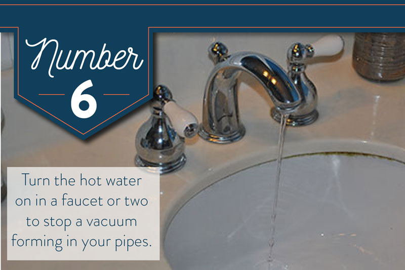 Turn on two faucets to remove a vaccum in your plumbing while draining your water heater.